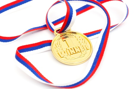 Golden medal whith ribbon isolated on white background photo