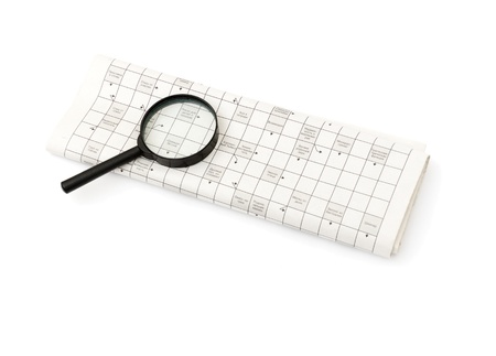 Magnifying glass over a newspaper classified section Stock Photo - 8471374