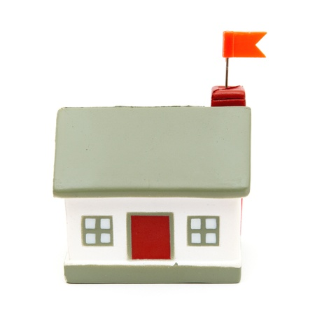 little house with flag isolated on white background photo