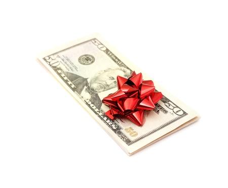 christmas profits: 50 Dollar with holidays bow isolated on white