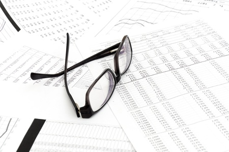 Accounting. black glasses lies on stack document photo