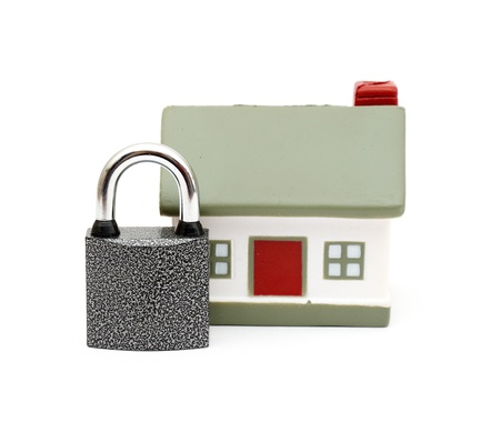 deadbolt: miniature house with lock and chain isolated on white Stock Photo