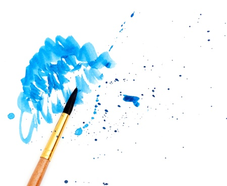 creativeness: brush with blue paint stroke and stick, isolated on white