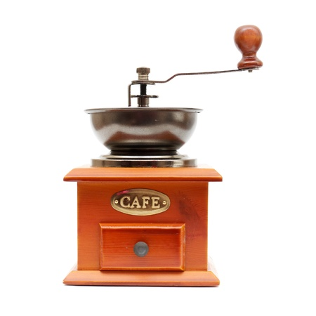 black appliances: old wooden worm eaten coffee mill isolated on a white background