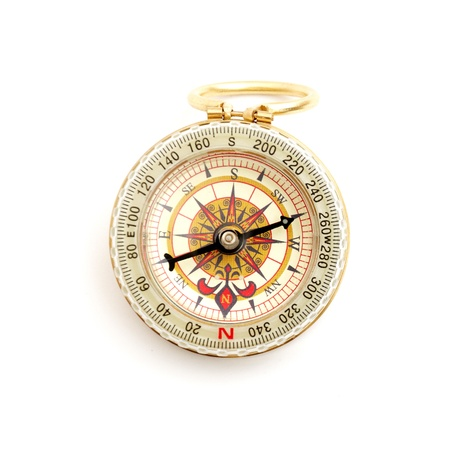old styled, gold compass on a white background. photo