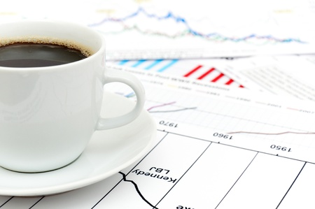 nyse: a tasty cup of coffee with the stock charts Stock Photo