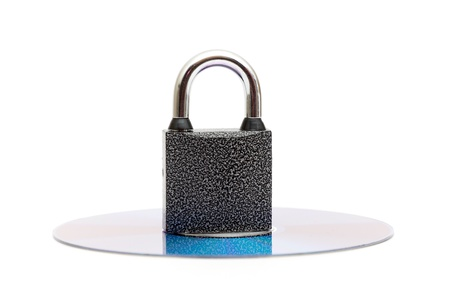 CD DVD media locked with a padlock isolated background photo