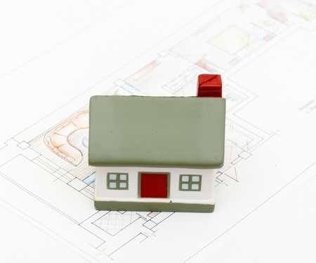 miniature house with various drafting items and plans. (i am author of this drawing) Stock Photo - 8539583