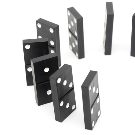 gambling stone: black domino stones isolated over white background