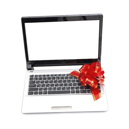 Gift laptop (red bow) isolated on white background Stock Photo - 8539759