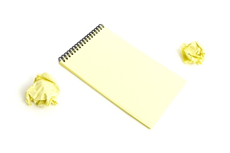 Notebook and crumpled paper isolated on white background photo