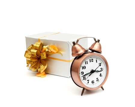A retro clock with presents isolated on white bacground Stock Photo - 8540024