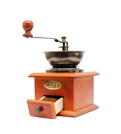 afilador: antiguo molino de caf� de madera gusano comido aislado en un fondo blanco Foto de archivo