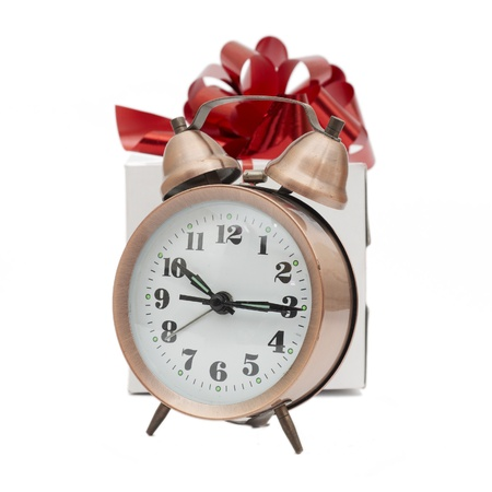 A retro clock with presents isolated on white bacground photo