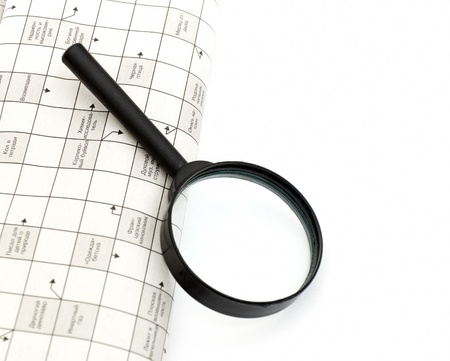 Magnifying glass over a newspaper classified section Stock Photo - 8593501