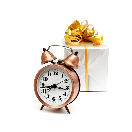 A retro clock with presents isolated on white bacground Stock Photo - 8628352