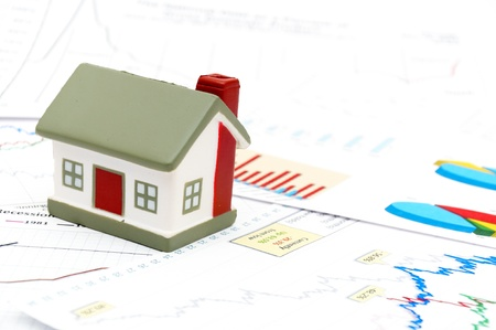 Housing market concept image with graph and toy house Stock Photo - 8628621