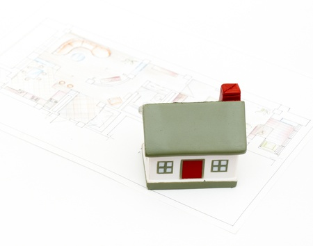 decline in values: miniature house with various drafting items and plans. (i am author of this drawing)