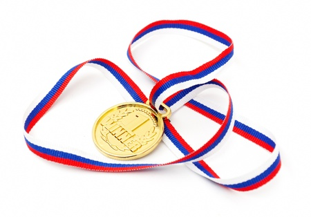 Golden medal and ribbon isolated on white background photo