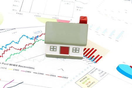 decline in values: Housing market concept image with graph and toy house Stock Photo
