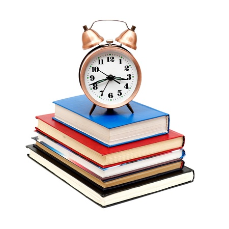 Back to school concept with books and clock photo