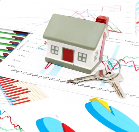 Housing market concept image with graph and toy house Stock Photo
