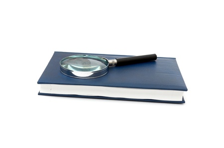 magnifier and book isolated on a white background photo
