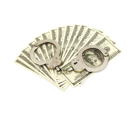 Handcuffs on money background photo