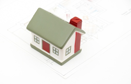 miniature house with various drafting photo