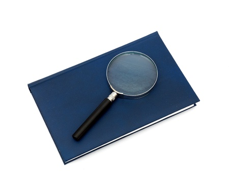 magnifier and book isolated Stock Photo - 8818765