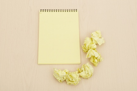 Notebook and crumpled paper photo