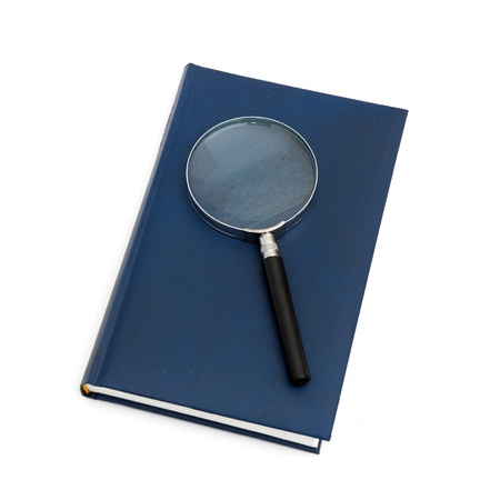 magnifier and book isolated on a white background Stock Photo - 8815001