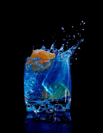 Orange in blue water splash Stock Photo - 8814302