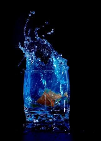 Orange in blue water splash on black background Stock Photo - 8918291