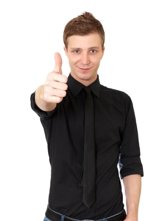 Happy casual young man showing thumb up  on white background photo