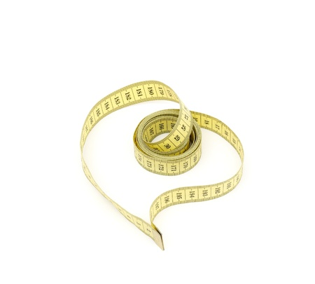 Measuring tape looking as heart isolated over white background Stock Photo - 8918338