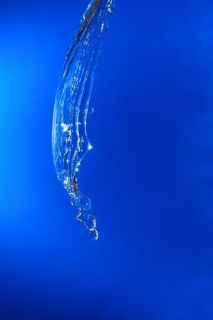 beautiful water splash on blue gradient background Stock Photo - 8918180