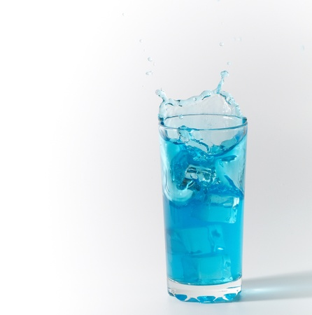 blue splash in glass from ice cube Stock Photo - 8918155
