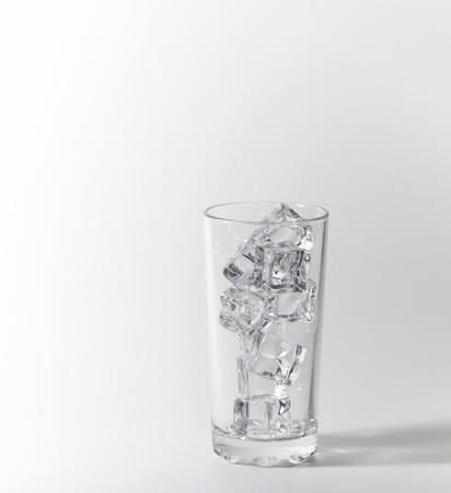 Glass with ice cubes. on white background photo