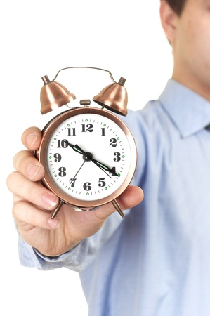 businessman with an alarm clock in a hand. Isolated on white background Stock Photo - 9050895