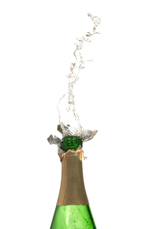 champaign: Bottle of champagne with splashes over white background
