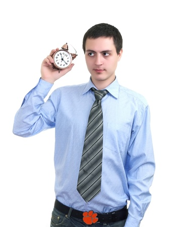 businessman with an alarm clock in a hand. Isolated on white background Stock Photo - 9049987