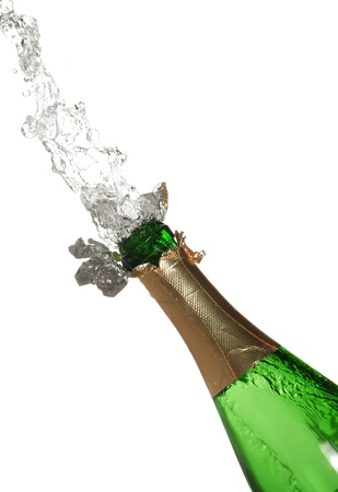 cider: Bottle of champagne with splashes over white background