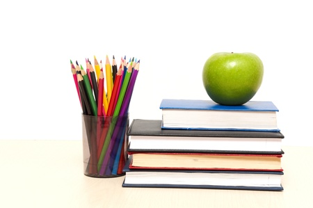 apple, books and colored pencil, back to school concept photo