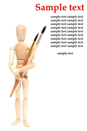 wood figurine: The art object brushes and doll on white Stock Photo