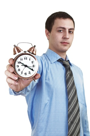businessman with an alarm clock in a hand. Isolated on white background photo