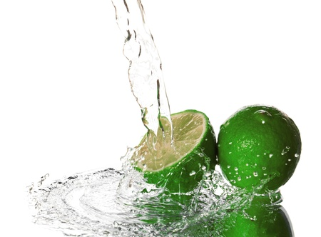 Water splash on lime isolated on white Stock Photo