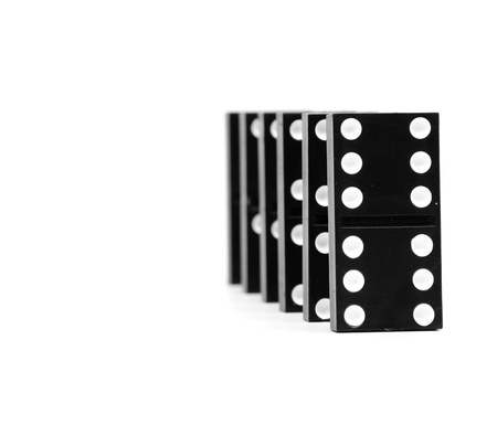 chain of dominoes isolated on a white background photo