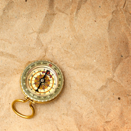 Vintage compass on the paper in adventure concept photo