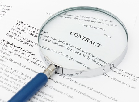 legal document: blue Magnifying Glass and document close up Stock Photo